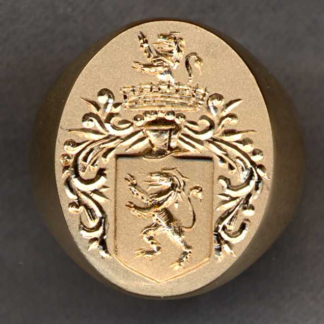 A 14k gold signet ring engraved with a Family Crest or Coat of Arms.