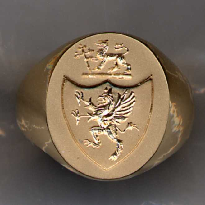 A man's gold Family Crest Ring.