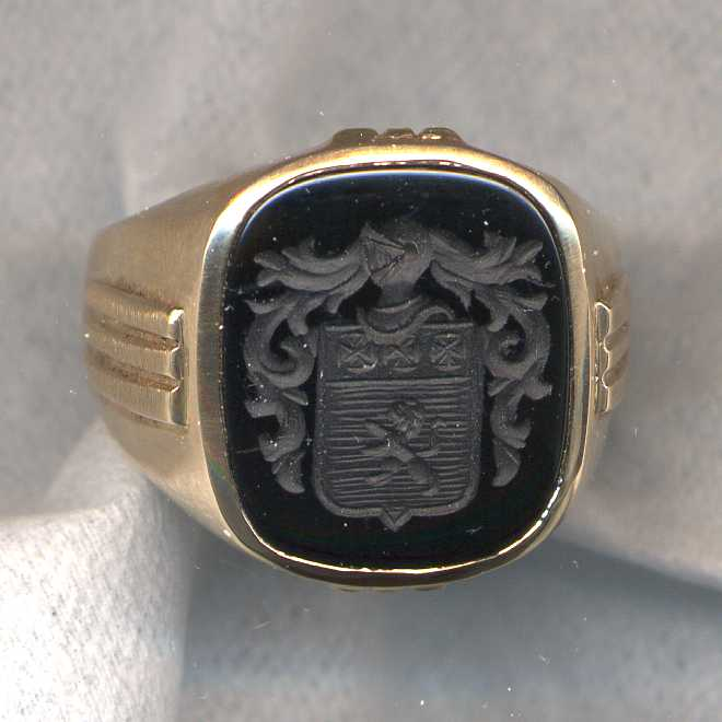 An old stone ring where we simply engraved family crest on the existing stone.