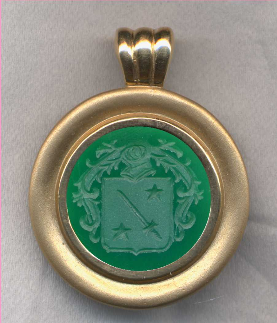 A stone (Green Onyx) Family Crest (Coat of Arms) Pendant.